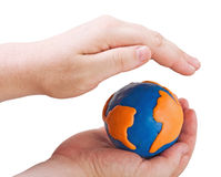 Globe symbolizing the land in the hands Stock Image