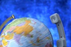 Globe with telephone stock image