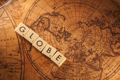 Globe. The text Globe with a map on background Vector Illustration