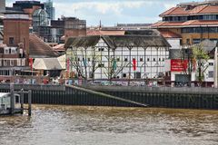 Globe Theatre. LONDON, UK - MAY 13, 2012: People visit Shakespeare's Globe in London. The cultural institution is a modern reconstruction of historic Globe Stock Photo