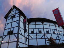 Globe Theatre at night. London, UK – January 27, 2013 : The  Globe Theatre at dusk advertising tours and exhibitions with banners Stock Photo