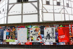 Globe Theatre Posters. London, England - August 21, 2014: Posters advertising performances at the Globe Theatre In London. The Globe is a reproduction of the Royalty Free Stock Image