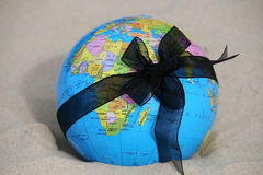 Earth globe. Globe tied with a black ribbon funeral. War, violence - the worlds destruction. Protecting the Earth royalty free stock photography