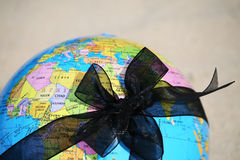 Earth globe. Globe tied with a black ribbon funeral. War, violence - the worlds destruction. Protecting the Earth Stock Photos