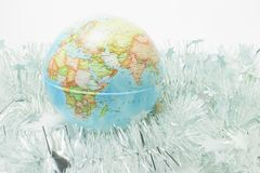 Globe with Tinsels Stock Photo