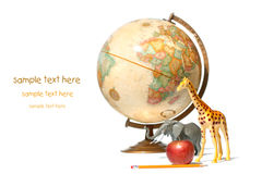 Globe with toy animals and apple on white Royalty Free Stock Photos