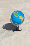 Globe on tropical beach Stock Photography