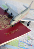 Globe-trotter. Toy plane on top of passport and map of Paris Royalty Free Stock Photography