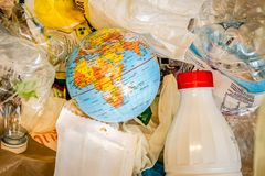 a globe trow in a waste stock image