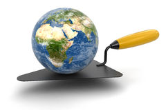 Globe and Trowel (clipping path included) Royalty Free Stock Image