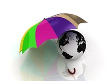 The globe under the colour umbrella Stock Images