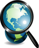 Globe under magnifying glass. Illustration, blue globe under magnifying glass on white background Stock Photo
