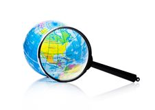 Globe under magnifying glass Amercia and Mexico. Globe under magnifying glass zooming North America, Mexico and Canada on white background Stock Photo