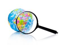 Globe under magnifying glass Asia and Africa. Globe under magnifying glass zooming Asia and Africa on white background stock photography