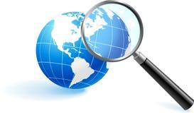Globe under magnifying glass.  Royalty Free Stock Photo