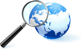 Globe under magnifying glass.  Royalty Free Stock Images