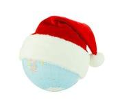 Globe utilisant le chapeau de Santa Photo stock