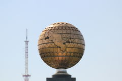 Globe with Uzbekistan and old TV tower in Tashkent Royalty Free Stock Photos