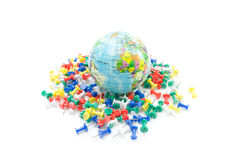 Globe on various push pin, isolated Royalty Free Stock Photo