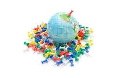 Globe on various push pin Stock Photos