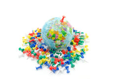 Globe on various push pin, isolated Stock Images
