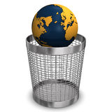 Globe In Wastebasket. On the white background Royalty Free Stock Images