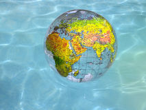 Globe in Water Royalty Free Stock Photos