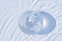 Globe and water Stock Photo