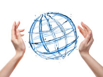 Globe from water with human hand isolated on white Stock Photo