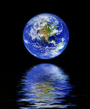 Globe with water reflection Royalty Free Stock Image