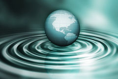 Globe on water ripples. 3D render of a globe on water ripples Royalty Free Stock Photo