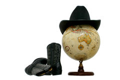 Globe with Western Hat and Boots. Black felt  hat on a globe with boots laying beside it. Austrailia facing front. Isolated on white Royalty Free Stock Photo