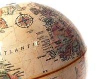Globe on white. An antique globe against a wahite background, as though for travel, diversity, international Stock Image