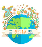 Globe on a white background, surrounded by flowers and leaves. The inscription on the banner of Earth Day, April 22 Royalty Free Stock Photos