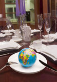 Globe in white dish. A globe in a white dish,look like will be eaten by someone Stock Photo
