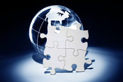 Globe and White Puzzle Stock Photo