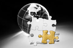 Globe and White Puzzle Royalty Free Stock Photography