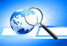 Globe With Magnifying Glass Stock Photography