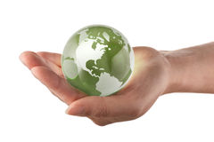 Globe in womans hand. Protecting the earth concept, world in a womans hand stock photography