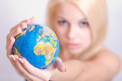 Globe in woman`s hands Stock Photo