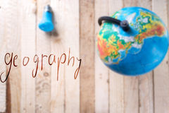 Globe on a wooden background. Stock Photo