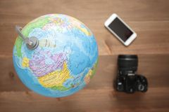 Globe on wooden background Stock Photography