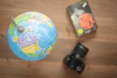 Globe on wooden background Stock Photo