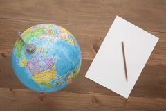 Globe on wooden background Stock Photos