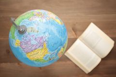 Globe on wooden background Stock Images