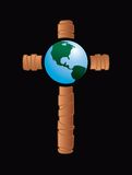Globe on wooden cross Royalty Free Stock Photos