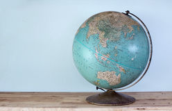 Globe on wooden plate Stock Photography