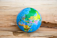 Globe on a wooden surface Stock Photo