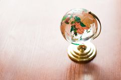 Globe on wooden table. Save Earth. model on wooden desk. wall empty space background stock image