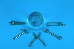 Globe and work tools Royalty Free Stock Photography